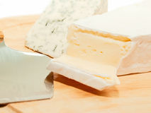 Brie and dor blue cheese on desk with knife Royalty Free Stock Photo