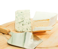 Brie and dor blue cheese on desk with knife Royalty Free Stock Photography