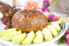 Brie en croute with apples and grapes Royalty Free Stock Image