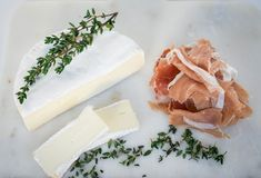 Brie with thyme and prosciutto stock photo
