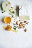 Brie and walnuts Royalty Free Stock Photography