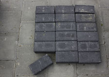 Briecks. Gray black bricks on street workingday Stock Images