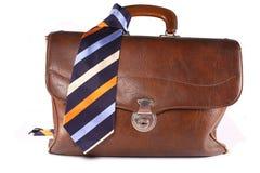 Brief-case with necktie. Vintage brown leather brief-case with necktie Royalty Free Stock Photos