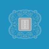 Brief H met vierkant kader van het patroon van de lijnenwerveling Koninklijk monogram Stock Foto