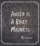 Brief madness Horace quote. Anger is a brief madness - ancient Roman philosopher Horace quote written on framed chalkboard royalty free stock image
