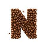 Brief N van chocoladebellen wordt de gemaakt, 3d die melkchocolaconcept, geeft terug Royalty-vrije Stock Afbeelding