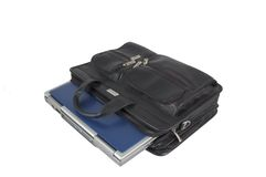 Briefcase 1. A blue laptop inside a leather briefcase on a white background stock images