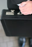 Briefcase. Close-up shot of man holding briefcase Royalty Free Stock Image