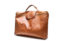 Briefcase. Brown leather briefcase isolated on a dark background Stock Image