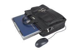 Briefcase. A blue laptop inside a leather briefcase with mouse on a white background stock photography