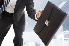 Briefcase. Close-up of the briefcase held by running businessman royalty free stock photos