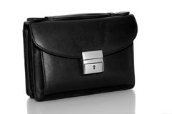 Briefcase. A picture of a black leather briefcase on a white surface Royalty Free Stock Image