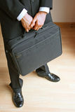 Briefcase. Businessman holding a black briefcase stock images