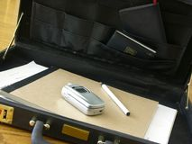 Briefcase. Partial briefcase with work related items in it Stock Photography