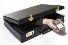 Briefcase. A Hand appears reaches out of a briefcase Royalty Free Stock Photos