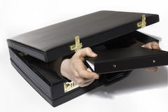 Briefcase. A Hand appears reaches out of a briefcase Royalty Free Stock Photo