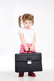 Briefcase. Little girl with black briefcase stock photography
