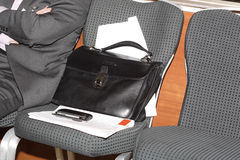 Briefcase on the armchair Stock Photo