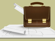 Briefcase with blueprints Stock Images
