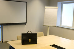 Briefcase in Board Room Royalty Free Stock Photos