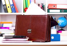 Briefcase. Brown leather briefcase on table at office royalty free stock images