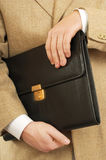 Briefcase. Business portfolio in the hands of men Royalty Free Stock Photos