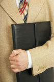Briefcase. Business portfolio in the hands of men Royalty Free Stock Image