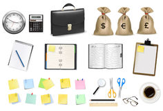 A briefcase, calculator and office supplies Royalty Free Stock Images