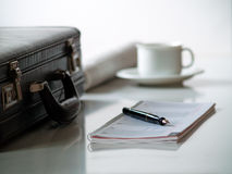 Briefcase with calendar. Briefcase with a calender, cup of coffee and a newspaper Royalty Free Stock Photography