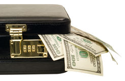 Briefcase with cash. A locked briefcase with American $100 bills coming out of the corner Stock Photo
