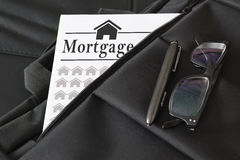Briefcase containing some mortgage loan document. Royalty Free Stock Photo