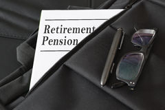Briefcase containing some retirement pension documents and reports. Royalty Free Stock Image