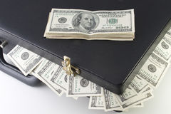 Briefcase with dollars royalty free stock image