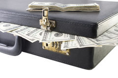 Briefcase with dollars. Briefcase full of dollars and package dollars over it royalty free stock photos