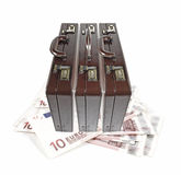 Briefcase on Euro currency. Three executive briefcase sitting on top a handful of Euro currency, isolated against white royalty free stock image