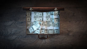 Briefcase filled with dollar packs Stock Photography