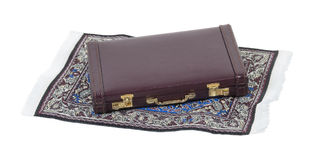 Briefcase on Flying Carpet Stock Photo