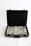 Briefcase full of cash Royalty Free Stock Image