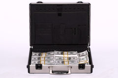 Briefcase full of cash Stock Photos