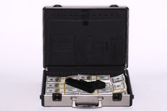 Briefcase full of cash and pistol Royalty Free Stock Images