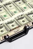 Briefcase full of dollars Stock Photo