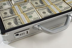 Briefcase Full Of Money. Cropped shot of briefcase full of money stock images