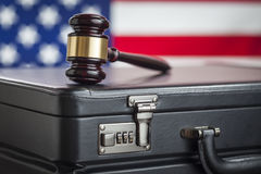 Briefcase and Gavel Resting on Table with American Flag Behind. Leather Briefcase and Gavel Resting on Table with American Flag Behind Stock Photos