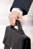 Briefcase in a hand Royalty Free Stock Photos