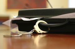 Briefcase and handcuffs. Files and documents safety and security concept Royalty Free Stock Photos