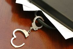 Briefcase and handcuffs. Documents safety and security concept Stock Photo