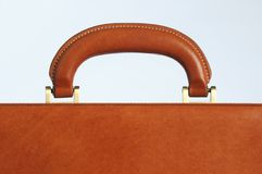 Briefcase handle. Close up of the handle on a leather business briefcase stock photo