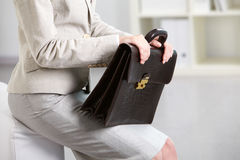 Briefcase in hands. Close-up of businesswoman holding briefcase royalty free stock photos