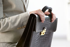 Briefcase in hands. Close-up of businesswoman holding briefcase stock photography