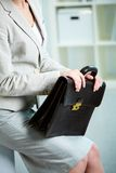 Briefcase in hands Stock Photography